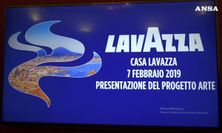 Lavazza celebra Napoli: sole, Vesuvio e tazzina in un murale