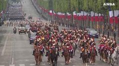 Fischi a Macron e scontri alla parata del 14 luglio